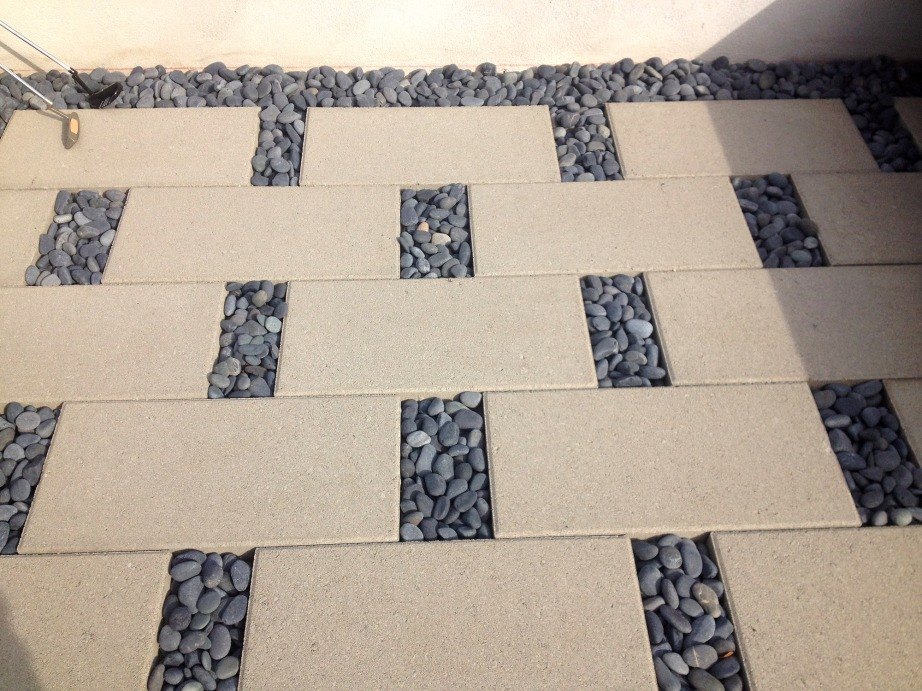 Brian Mitchell (AHBE Staff) incorporate the use of unit pavers and cobblestone to create an interesting design allowing run off to percolate through the cobblestone gaps.
