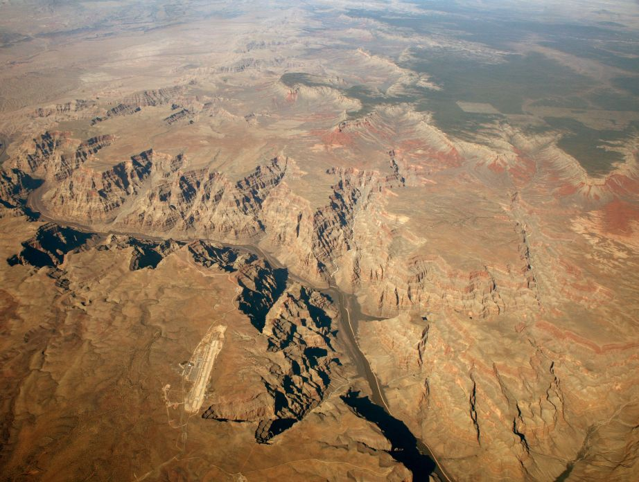 Creative Commons photo by Doc Searls: Aerial view: Grand Canyon West Airport at left center. Grand Canyon National Park lands (top), north of the Colorado River.