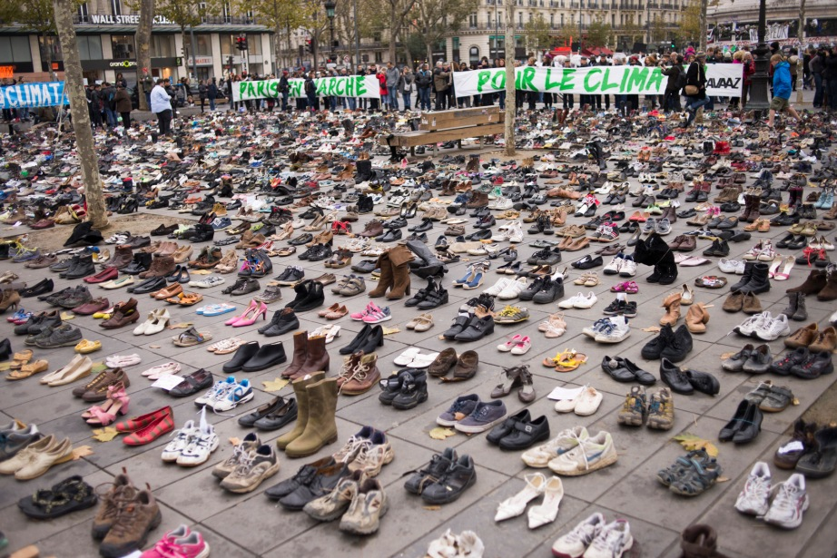 Thousands of empty shoes stand in silent protest at Paris' Place de la Republique, a symbolic call for climate change action.