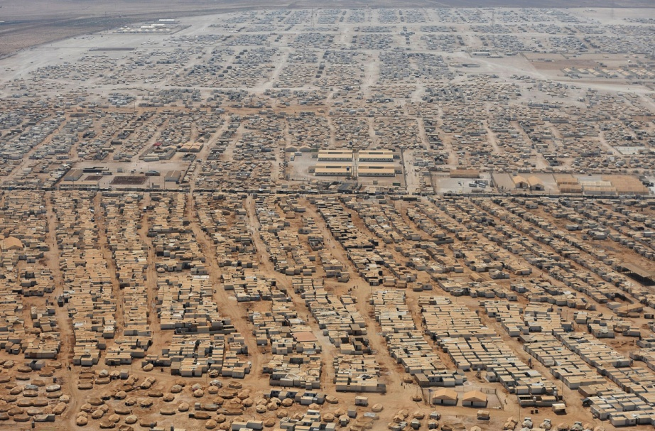 An aerial view shows the Zaatari refugee camp, near the Jordanian city of Mafraq, on July 18, 2013, a camp that holds roughly 115,000 Syrian refugees in Jordan about 12 km (eight miles) from the Syrian border. Via Photos of the Week