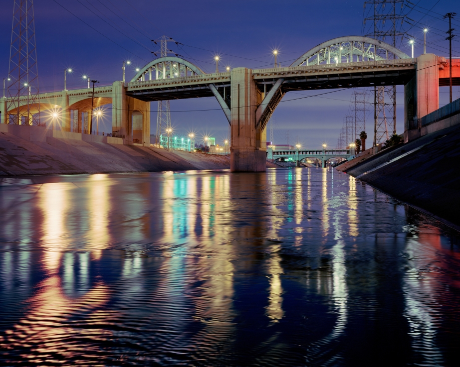 KCET Departures has a small collection of photos in remembrance of the historic Sixth Street Viaduct, including this dramatic photo by by Edwin Beckenbach.