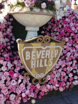 Close up of a float depicting the iconic City of Beverly Hills signage in roses.