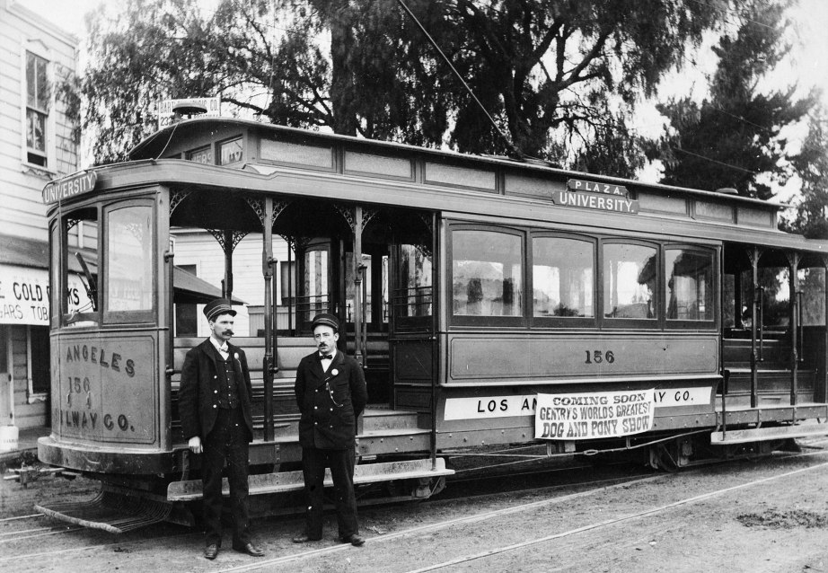 Plaza University trolley car of the Los Angeles Railway Company, showing two conductors posed in front, ca.1900-1910. Photo: Public Domain